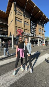 Ellyce and Rachel standing in front of Cheney Stadium